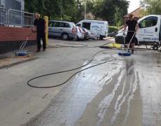 Power washing a supermarket car park