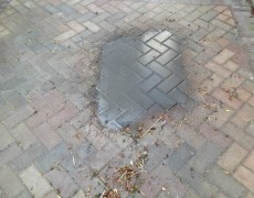 Driveway during oil stain removal