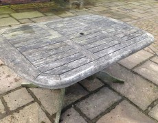 Garden table before pressure washing
