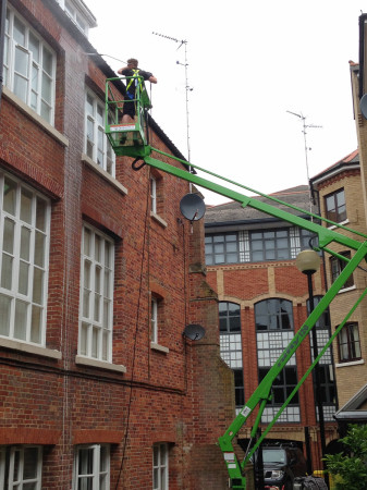 high level pressure washing from access platforms and cherry pickers