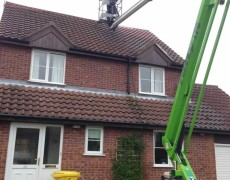 jet washing roof tiles on a house