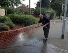 Norfolk pressure washing - cleaning a brick wall
